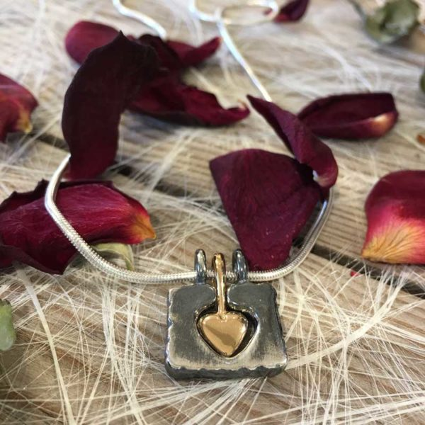 Embrace my heart - Håll Om Mitt Hjärta, 18K gold and 925 sterling silver pendants, handcrafted by GULDVIVA